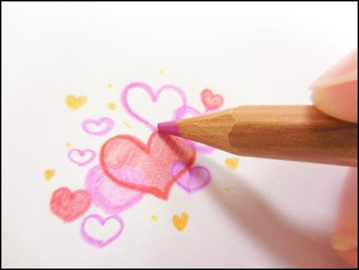 ハートを書いている画像