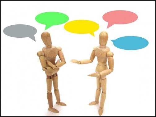 話し合いする人形の画像