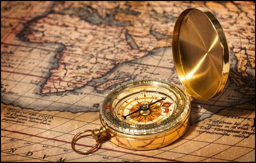 世界地図とコンパスの画像