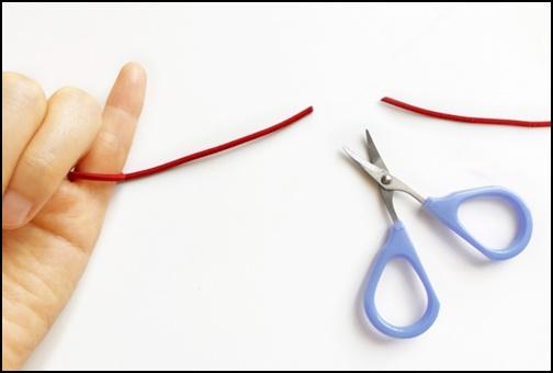 赤い糸を切った画像