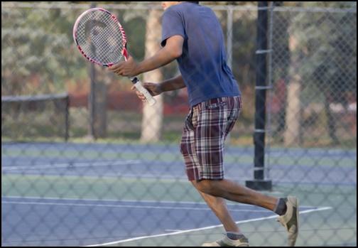 テニスをしている画像