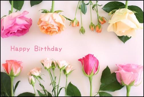 誕生日のメッセージカードとバラの画像