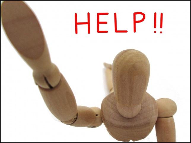 人形がHELP、ヘルプ、助けての画像